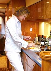 Preparing food in galley of yacht